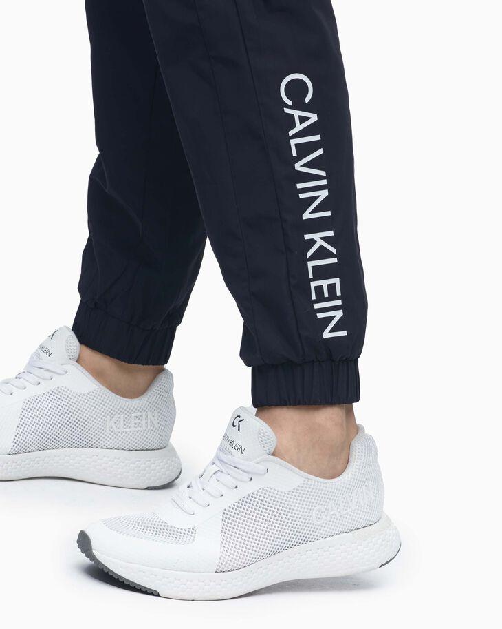 CALVIN KLEIN CORE TAPE WOVEN PANTS