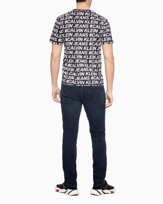 CALVIN KLEIN 남성 로고 올오버프린트 레귤러핏 반팔 티셔츠