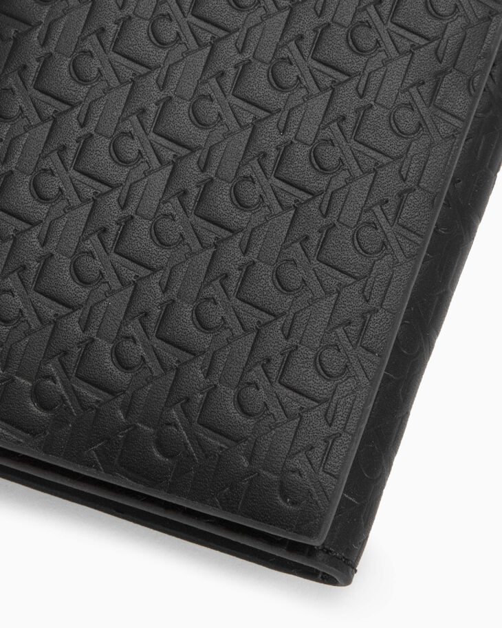 CALVIN KLEIN EMBOSSED MONOGRAM FOLD CARD CASE