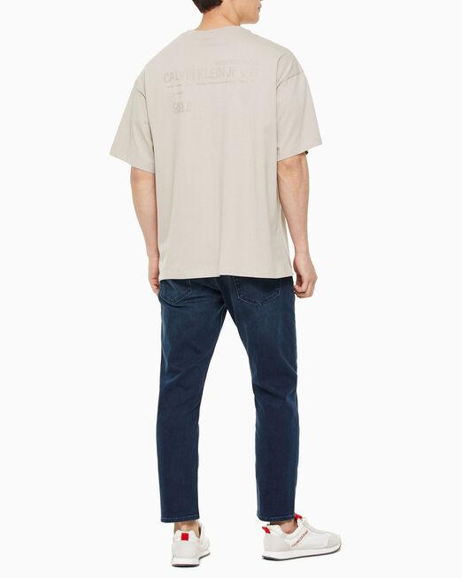 CALVIN KLEIN 남성 오버사이즈 백 그래픽 스케이트 티셔츠