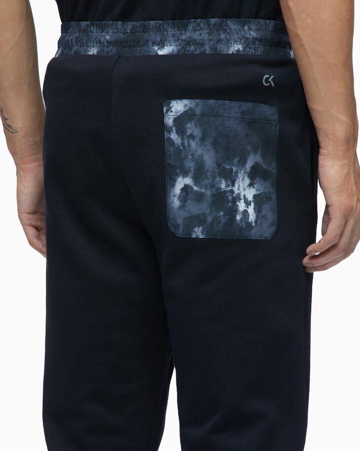 CALVIN KLEIN ORGANIC MOTION KNIT SWEAT PANTS
