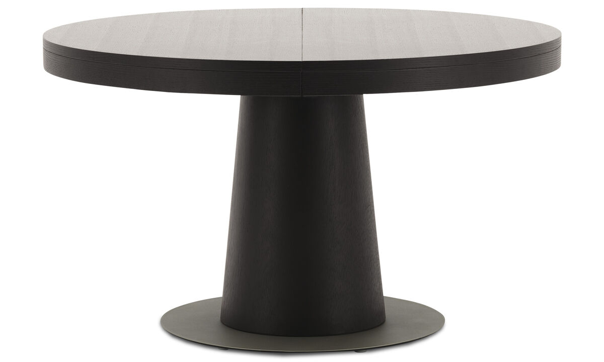 Dining rooms - Elegant leather sits beside black oak in this rich